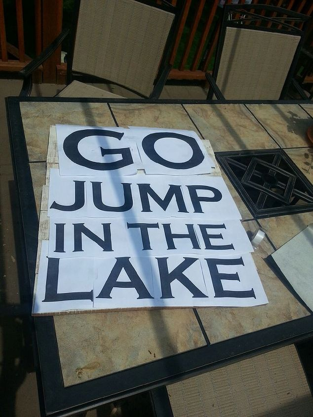 go jump in the lake pallet sign, crafts, pallet, I tape the letters to the board and grab the handy dandy carbon paper and start tracing