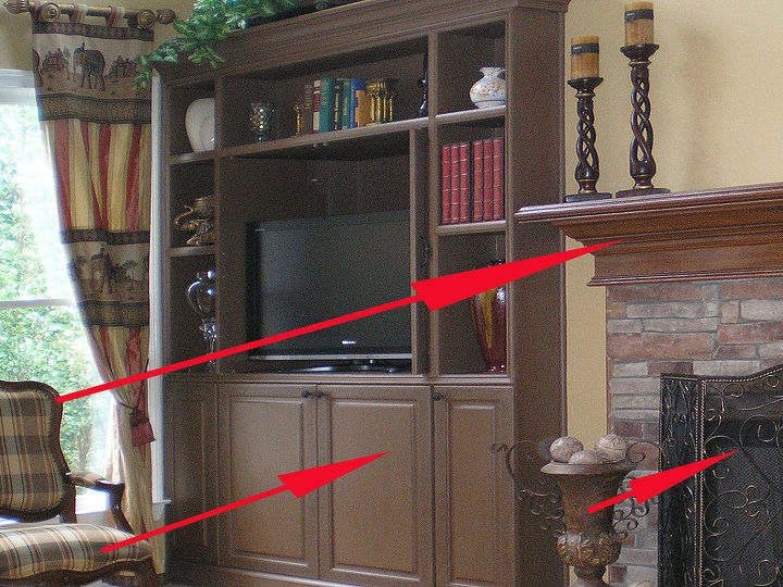 1) Mantel painted to appear like real wood that matches the client's existing furniture 2) Color for bookcases inspired by subtle tones in the fabrics 3) Bronze highlights on fire screen and doors to blend with her accessories.