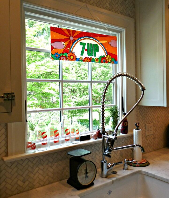 1970's Peter Max 7-Up sign as window treatment.  See more pics here: http://eclecticallyvintage.com/2012/05/the-un-window-treatment/