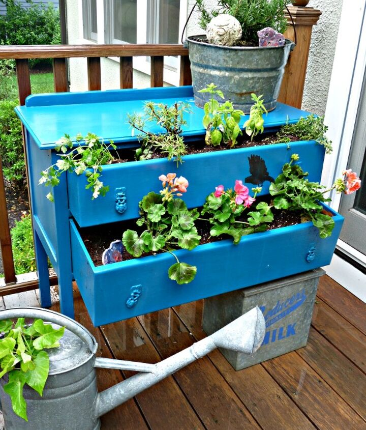 Old dresser turned outdoor planter.  See how here: http://eclecticallyvintage.com/2012/05/dress-up-your-plants-with-a-dresser/