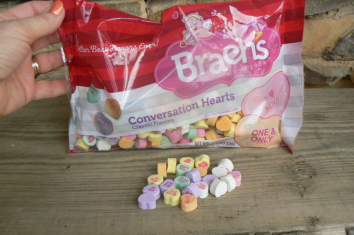 Brach candy hearts or you could use red hots and red roses.