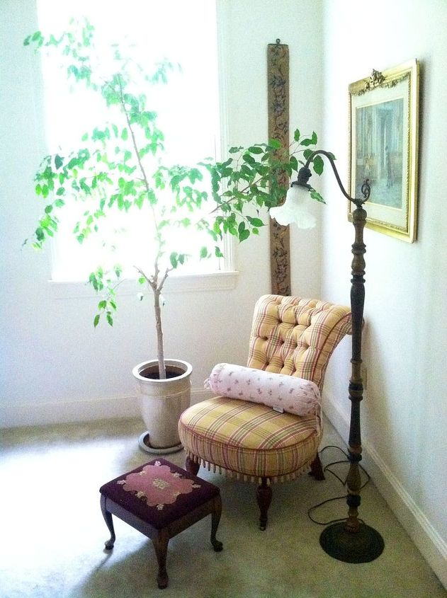 A little bedroom sitting area. The antique chair was reupholstered. I love the trim at the bottom Grandma chose!