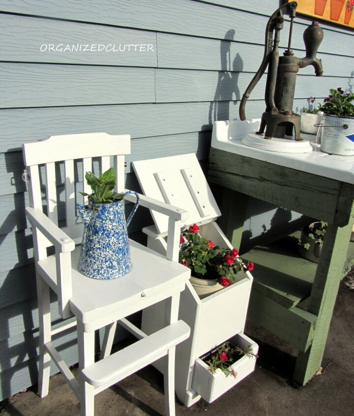 Further to the left a vintage high chair and my potato/onion bin re-purposed to hold flowers.