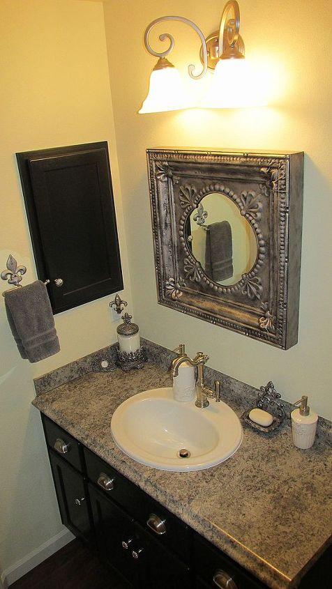 AFTER: Powder Bath new counter, no longer banjo shaped, new sink, new faucet & new flooring.