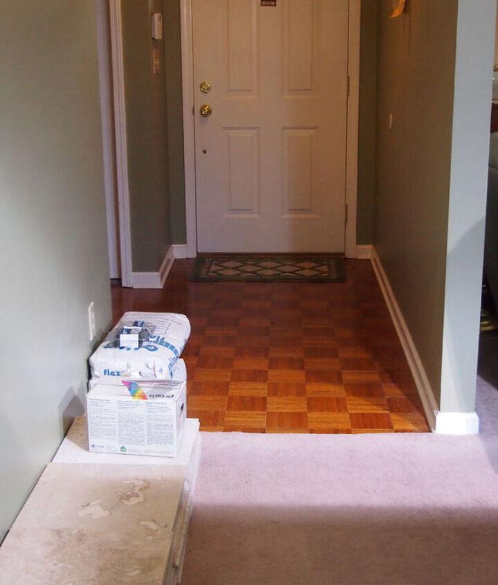 Looking into entryway and front door from breakfast area.