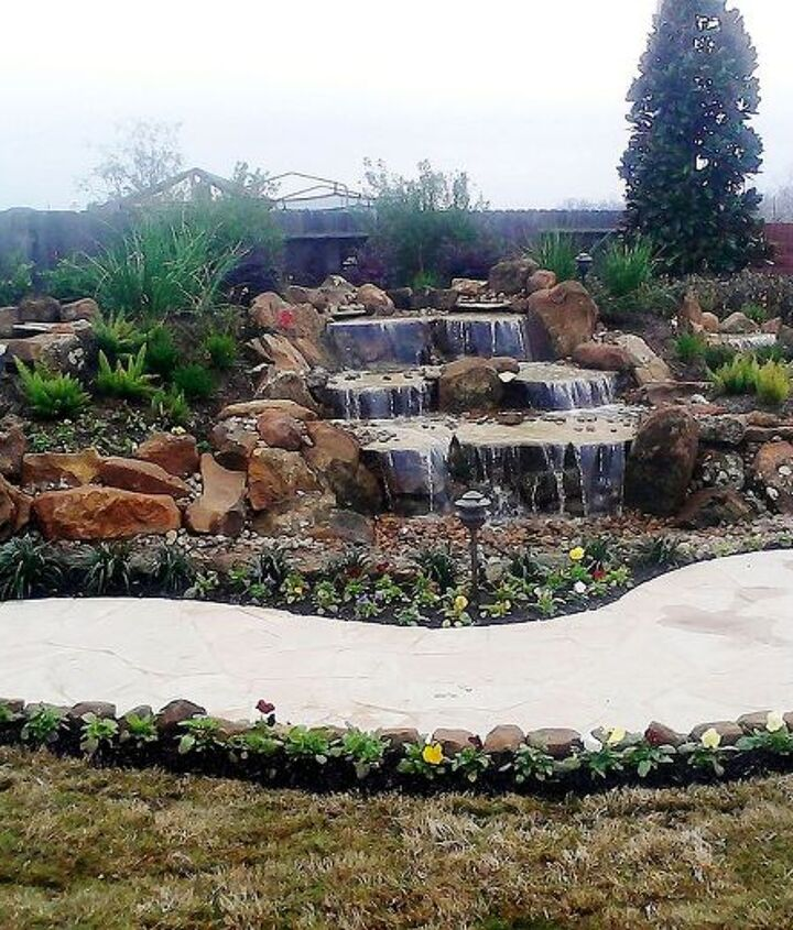 Stunning pondless waterfall in Ft. Bend County. Disappearing waterfalls are very low maintenance.