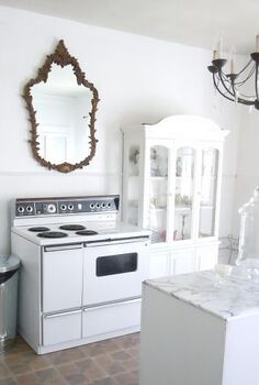 budget friendly kitchen makeover, home decor, kitchen design, kitchen island, The stove is my favorite part 1959 GE stove FREE from Craigslist The chandelier was 2 at a yard sale The mirror is an unconventional pop of contrast above the stove