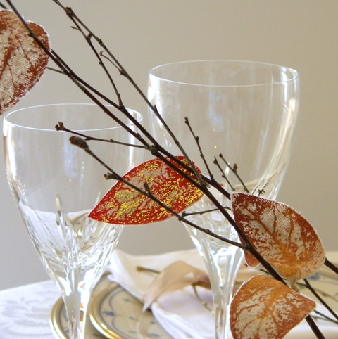 Glitter paint stenciled leaves.