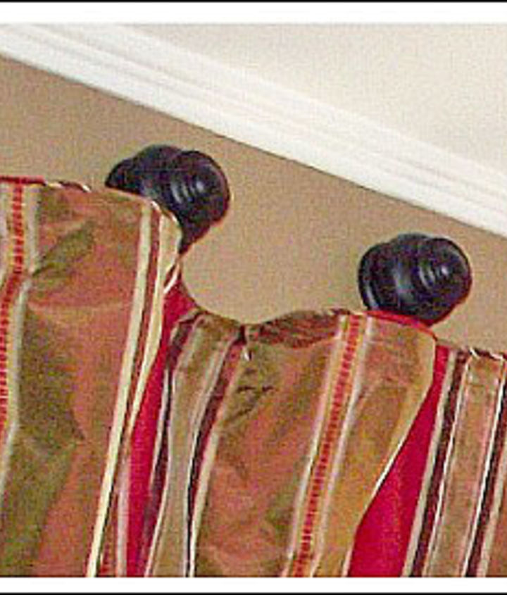 My unique drapery hardware idea was to use wood finials, drapery rings, and drapery hooks to hang these panels. The finials came in a two-pack for $7! For more detailed instruction just click on the link I provided. Thanks!