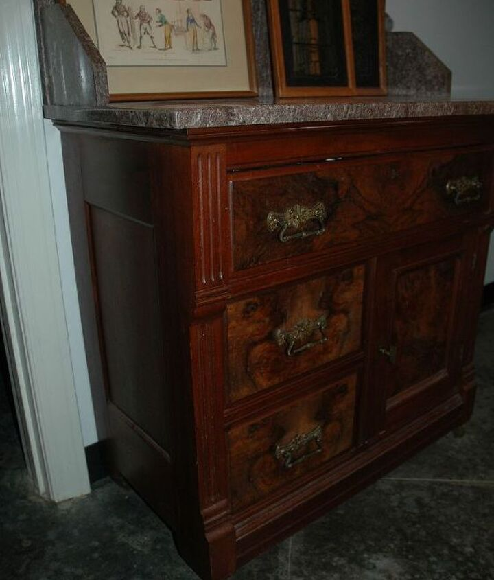 The washstand (with a little hole on the otherside for the chamber pot).
