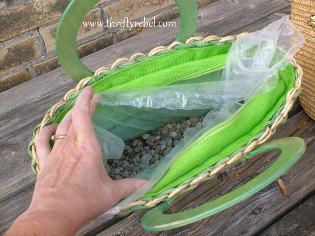 """Cut the bag to size and insert into the purse. Then add about 2"""" of pea gravel into the bottom."""