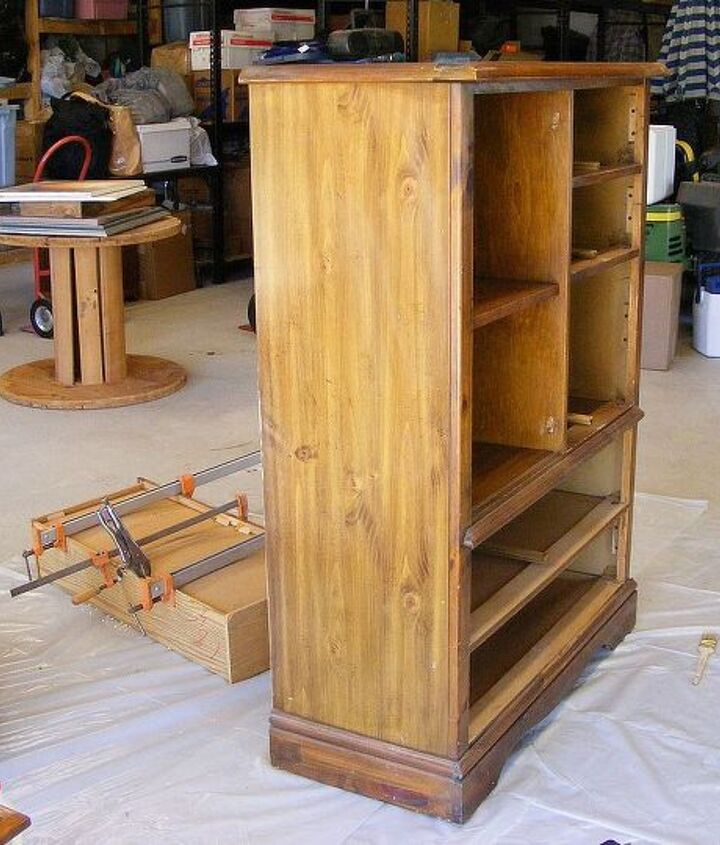 I began taking the chest apart to sand and re glue the worn drawers.