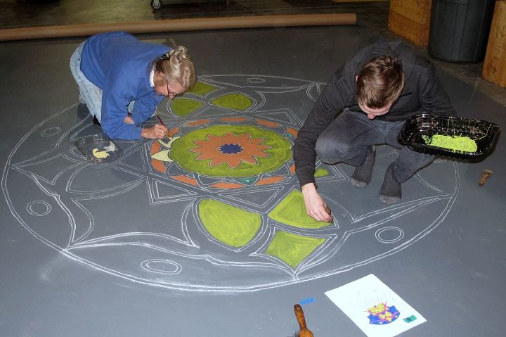 It was laid out on the floor where the design was painted starting from the inside and working outward.