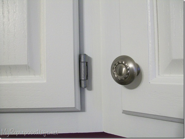 I painted my hinges and installed new knobs instead of the brass colored handles.