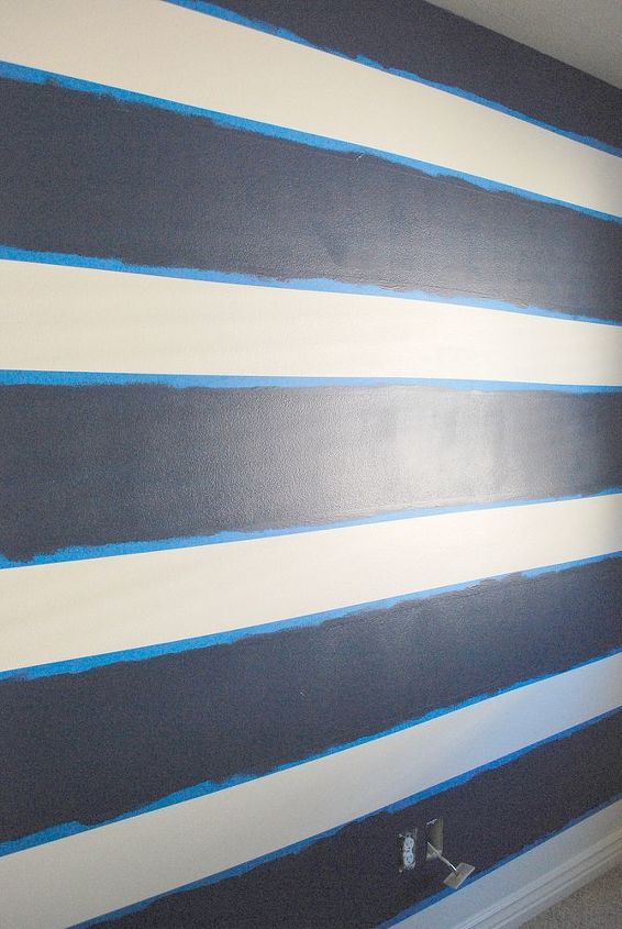 Roll on the stripe color over your taped background.  After it dries for several hours – paints vary so make sure to check the can – remove your painter's tape.