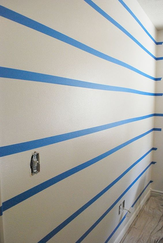 The hardest part about creating painted stripes is the measuring and taping.  Make sure to measure accurately (using a level helps.)  Also, make sure you choose a good painter's tape.  It will save a lot of touch ups later on.