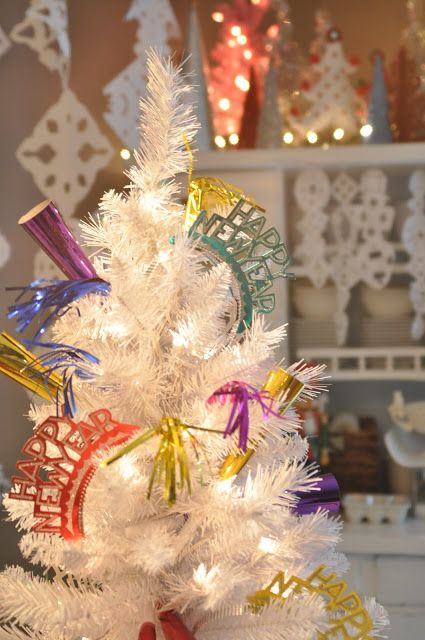Don't get rid of your tree yet.  Add some fun party favors from the Dollar Store for a festive look.  Source DomesticFashionista.com.