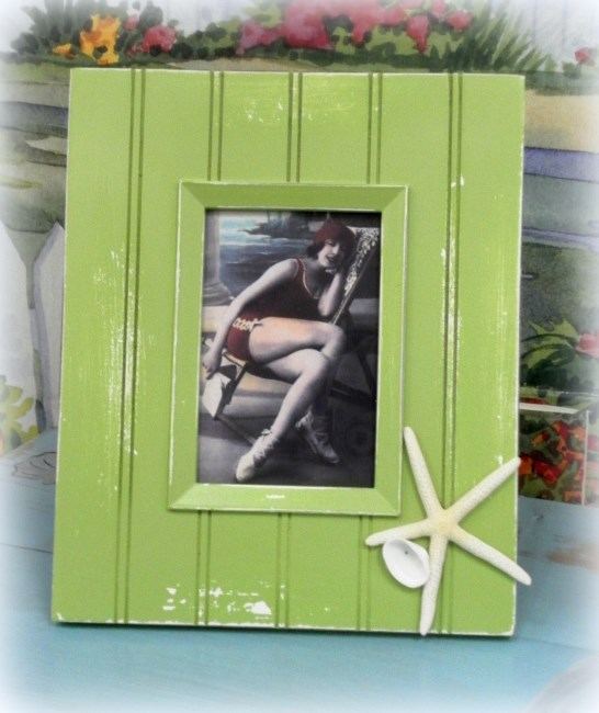 A vintage inspired bead board inspired picture frame.
