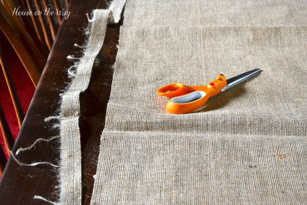 Cut the burlap runner to accommodate the size of your table.