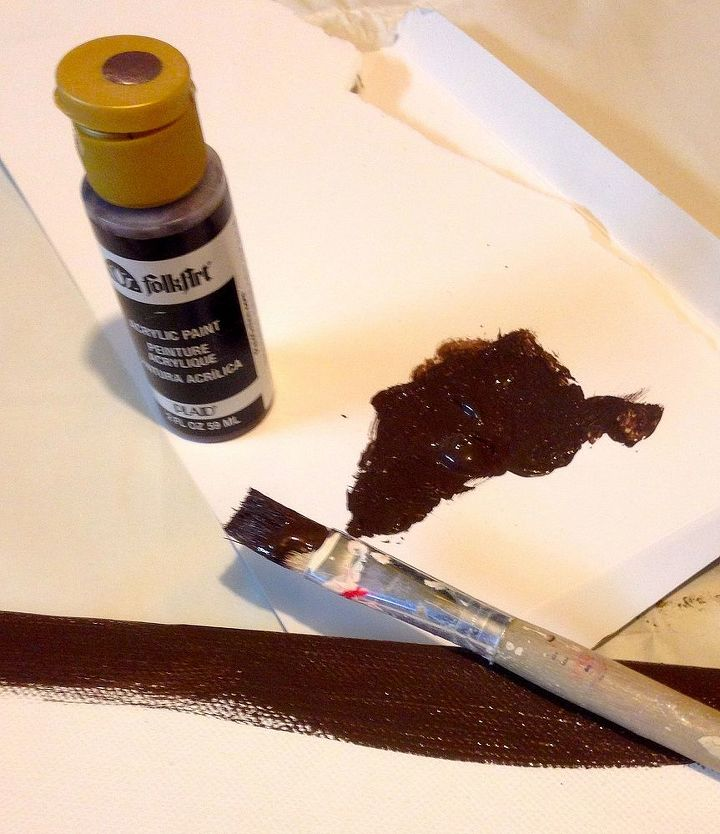 The edges of the canvas were painted a dark brown (using craft paint) just to give it a more finished look.