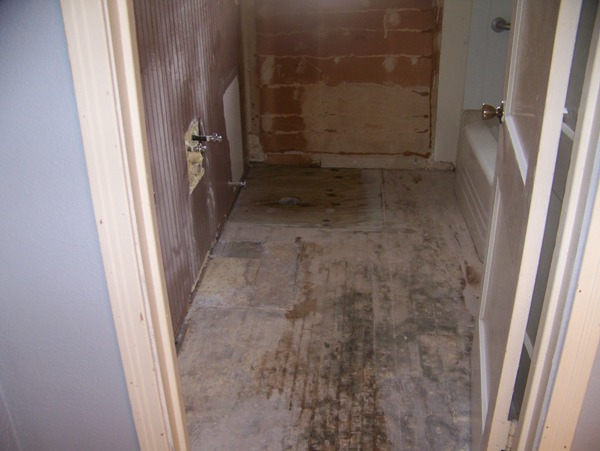 Everything out and old flooring removed...Went with linoleum flooring that looks like tile due to budget, and ease of installation