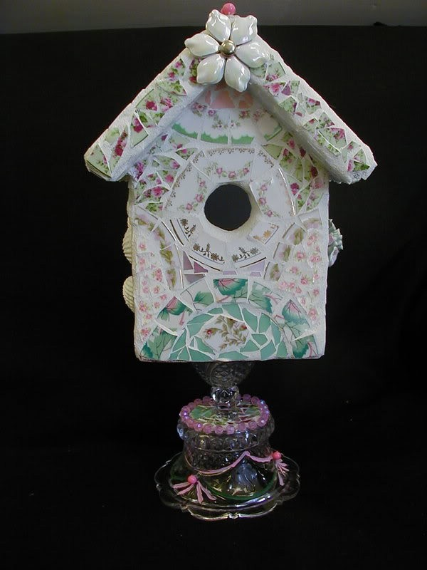 This is a birdhouse for indoor decor only.  Each side of the roof and all four sides are different, but with the same color scheme.  I used a glass compote for the pedestal and then painted some of the etched part and added jewelry.