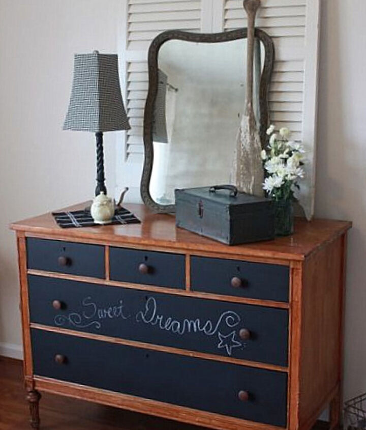 A plain wooden dresser got dressed up with chalkboard painted drawers. The two tall white shutters add emphasis to the pretty vintage mirror, giving the entire dresser more presence.