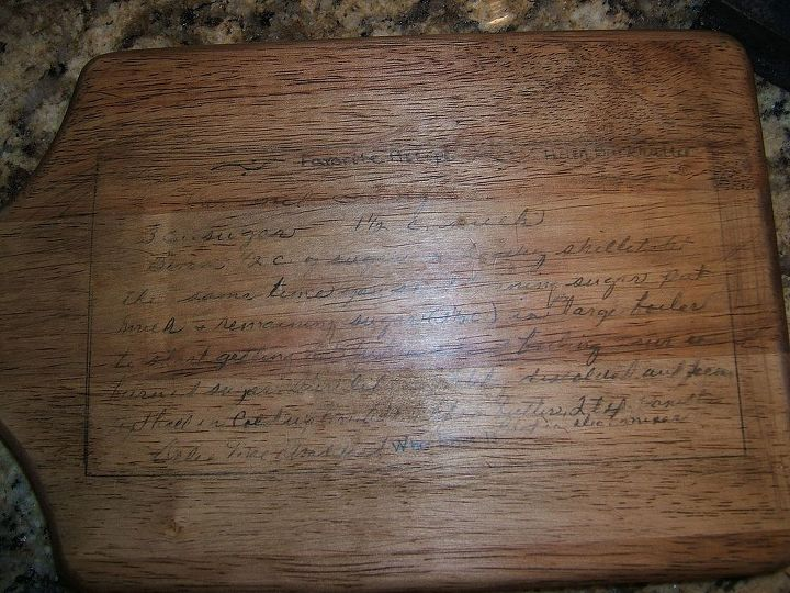 """I turned the toner based copy toward to cutting board to """"iron"""" with the transfer tool. I stained the cutting board to age it and added Wipe On Poly as a top coat. Sorry this photo has a glare!"""