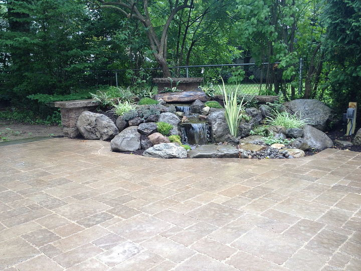 Brighton NY Waterfall Water Feature Rock Garden by Acorn Landscaping of Rochester NY  This area is now more inviting and an extension of the house. Contact us now to learn more about these Low Maintenance Water Features.
