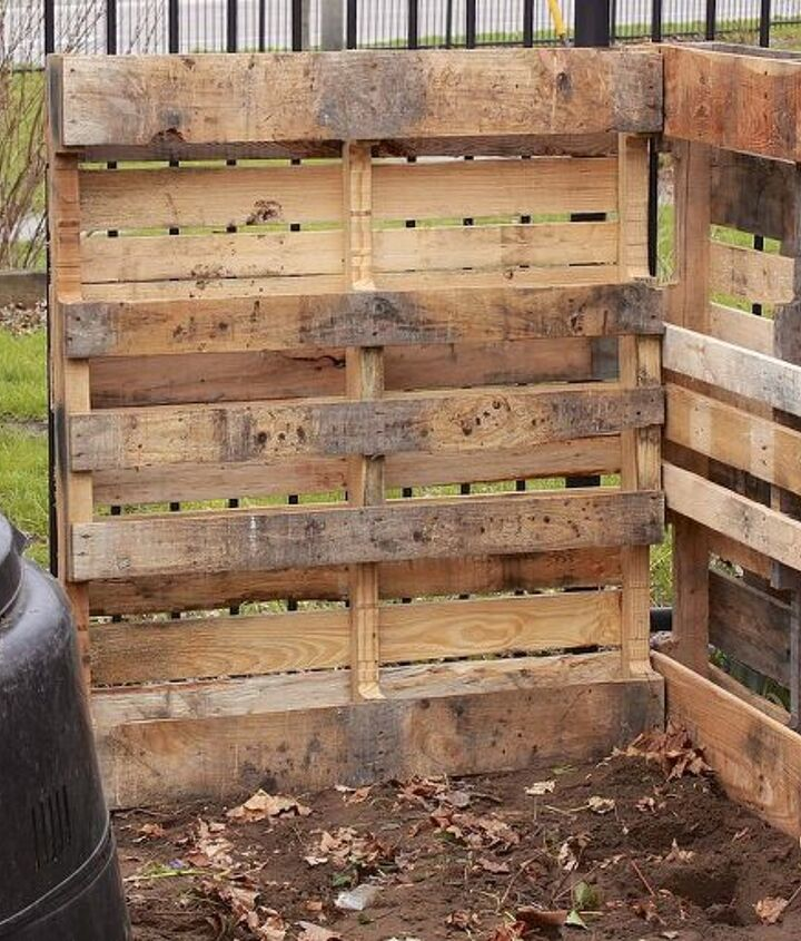 You'll need five pallets to get a two tiered system. Start by creating a back wall and securing another pallet for a side wall.