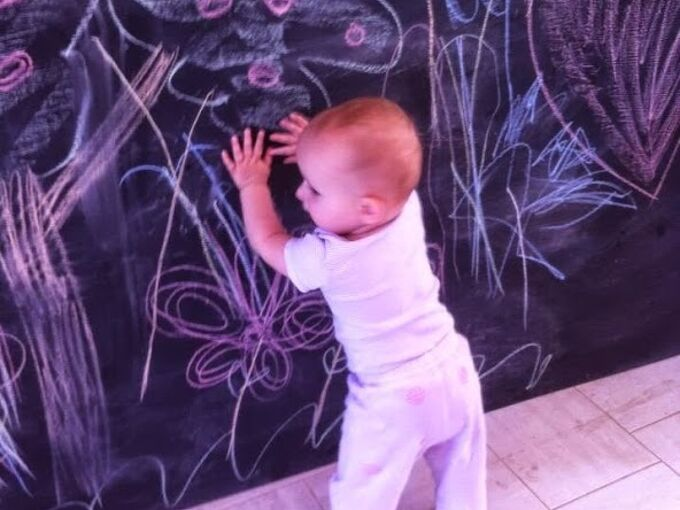 make a diy kids chalkboard, chalkboard paint, crafts, my 12 month old checking out the chalk drawings