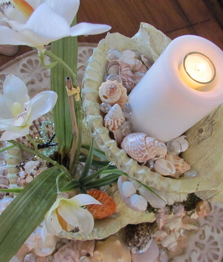 The top shell has a battery pillar candle that no longer worked so I found a small votive. Added smaller shells