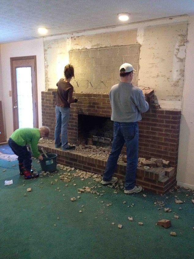 The brick wall coming down.