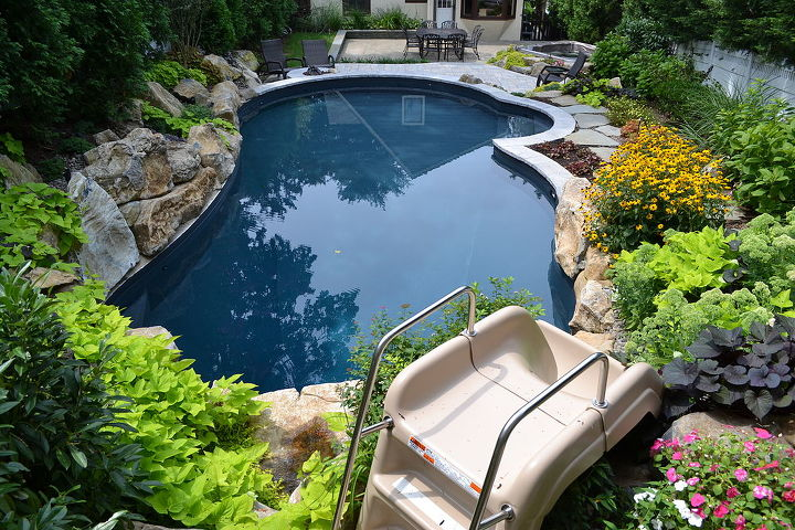 Pool slide into this vinyl pool and spa
