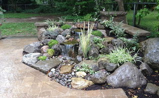 landscape design waterfalls water feature paver patio sitting wall with pillars, outdoor living, patio, ponds water features, Pondless Waterfall with Low Voltage Lighting and Rock Garden by Acorn Landscaping in Brighton NY Boulder Fountain with Waterfalls and easy to take care of Rock Garden