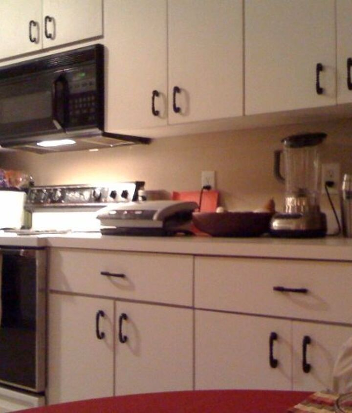Want to put lights under the cabinets to the right of the microwave