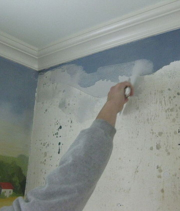 We patched the walls to render them smooth before re-priming and painting the replacement art.