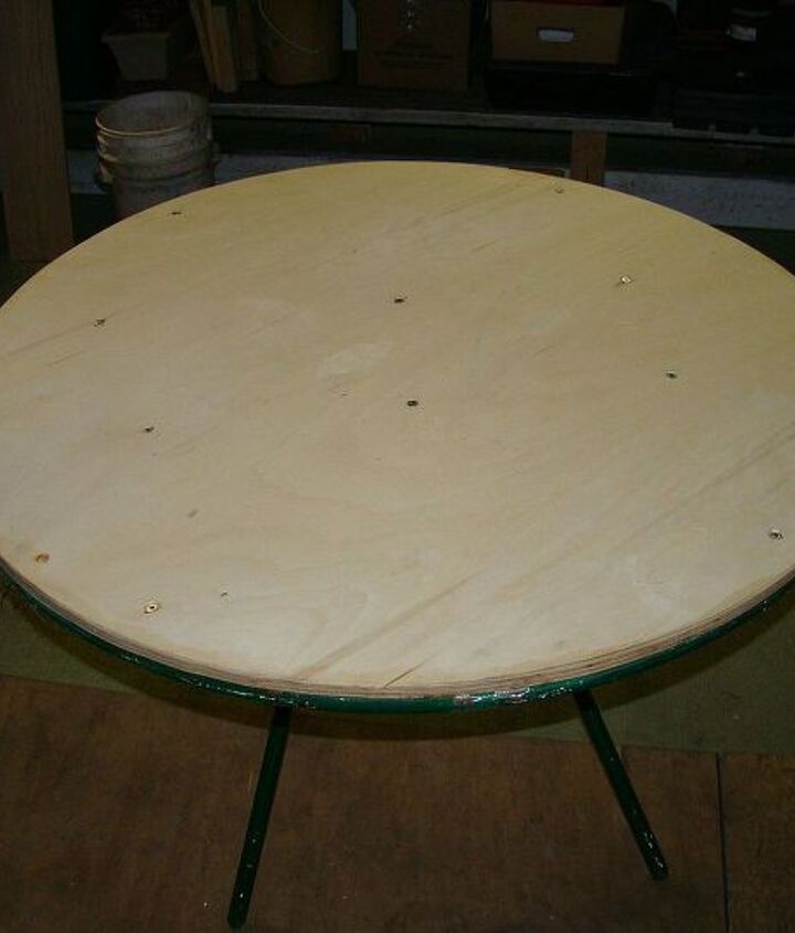 Secure plywood to stabilize the metal table that can easily bend otherwise.