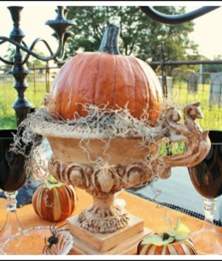 I purchased this plastic pumpkin from Hobby Lobby.  It looked so fake. SO, I antiqued it with antiquing gel.  Much better!!