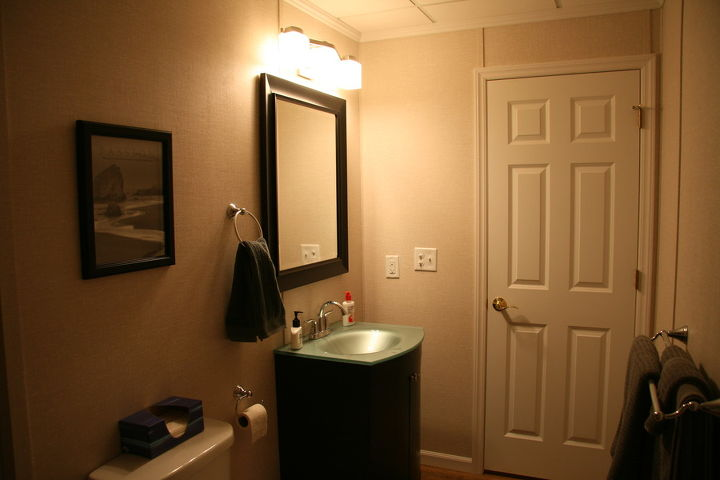 A bathroom complements the basement finishing project.