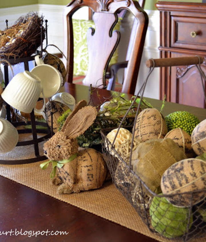 Burlap covered eggs in an aged wire basket combined with decorative orbs.