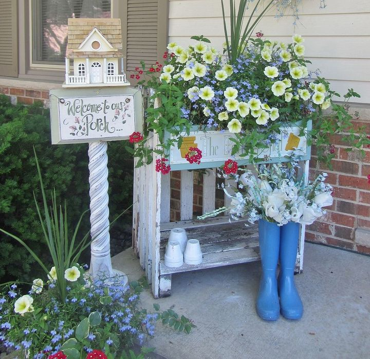 On my porch I used an old vintage picket fence to make this potting table.  Took a bird house and placed it onto an old architectural post.  Using the vintage items brings character and whimsy to the garden