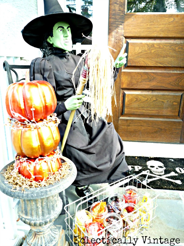 Helga stands watch over the candy http://eclecticallyvintage.com/2012/10/enter-if-you-dare-halloween-house-tour/