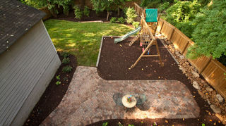 q soon to be delivered swing set want to prep area what is the best material for the, outdoor living, This playground area we installed within the new landscaping has composite railroad ties with a thick layer of playground safe mulch