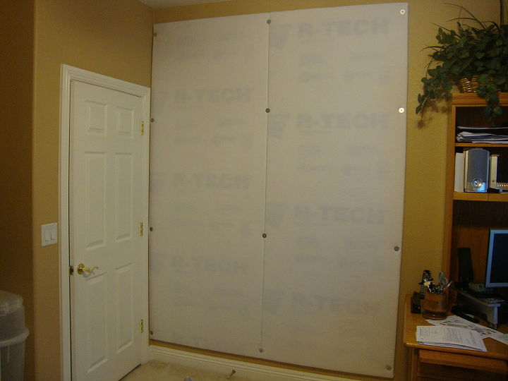 The boards were mounted to the wall with screws and washers. I figured I would make use of the space behind the door.