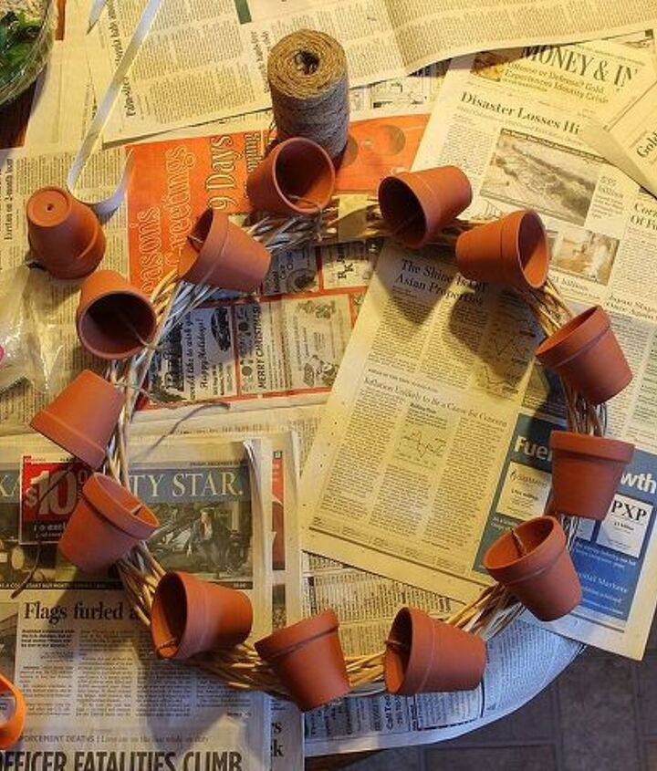 A combination of hot glue and twine worked to secure the pots.