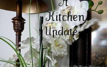 a small kitchen make over, home decor, kitchen design, Orchids to soften the metal lampshade