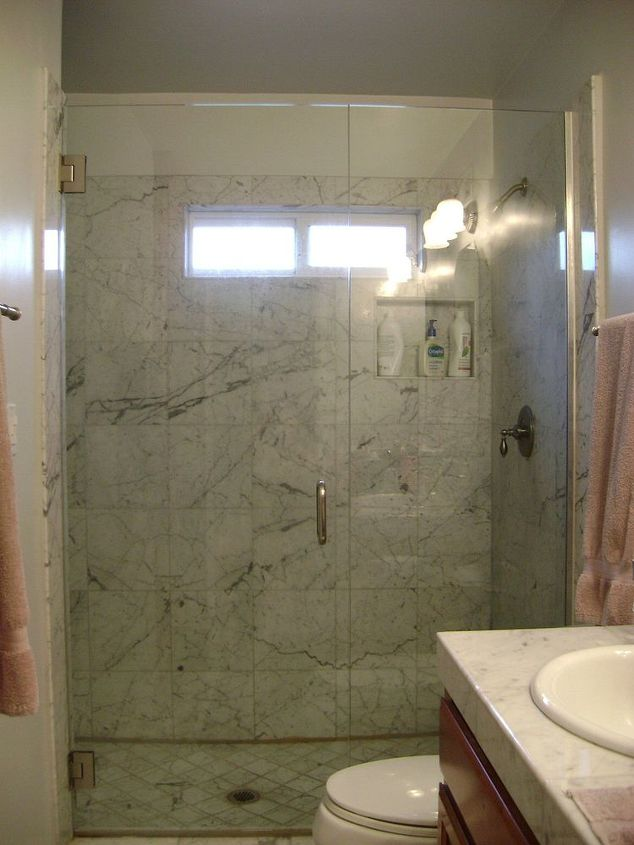 I took care of cleaning the shower glass - which looks great.  But the marble inside the shower is quite coated with white scale - although hard to see in this photo.