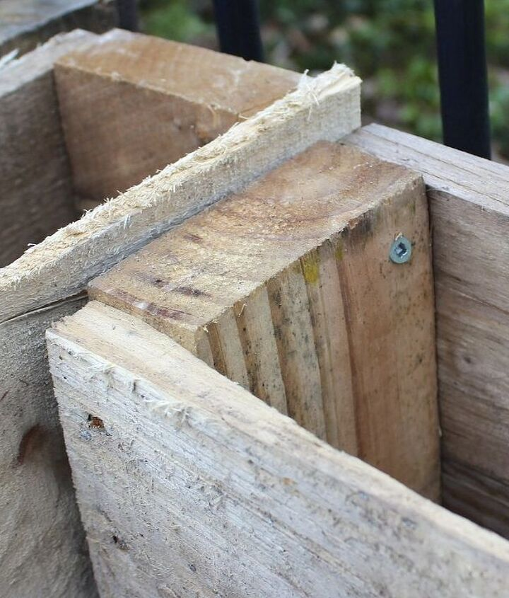Use long deck screws to attach the pallets top, middle and bottom of each side.