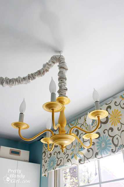 $5 brass chandelier got a spray painted makeover with summer squash color.